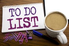 Hand writing text caption inspiration showing To Do List. Business concept for Plan Lists Remider written on note paper on the woo Stock Image