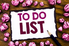 Hand writing text caption inspiration showing To Do List. Business concept for Plan Lists Remider Written on sticky note paper, wo stock image