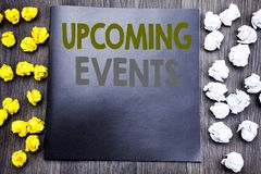 Hand writing text caption inspiration showing Upcoming Events. Business concept for Appointment Agenda List Written on notepad not. E notebook wooden background Royalty Free Stock Photos