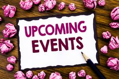 Hand writing text caption inspiration showing Upcoming Events. Business concept for Appointment Agenda List Written on sticky note stock photos