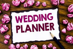 Hand writing text caption inspiration showing Wedding Planner. Business concept for Marriage Preparation Written on sticky note pa. Per, wooden background folded Stock Images