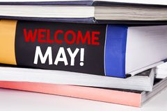 Hand writing text caption inspiration showing Welcome May. Business concept for Hello Month Greeting written on the book on the wh. Hand writing text caption Stock Photo