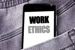Hand writing text caption inspiration showing Work Ethics. Business concept for Moral Benefit Principles written mobile cell phone. With space in the back pants Stock Images