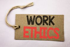 Hand writing text caption inspiration showing Work Ethics. Business concept for Moral Benefit Principles written on price tag pape. R on white vintage background Stock Photos