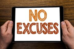 Hand writing text caption No Excuses. Business concept for Stop Ban for Excuse Written on tablet laptop, wooden background with bu. Hand writing text caption No Royalty Free Stock Photo