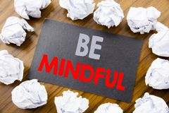 Hand writing text caption showing Be Mindful. Business concept for Mindfulness Healthy Spirit written on sticky note paper on the. Hand writing text caption Stock Images