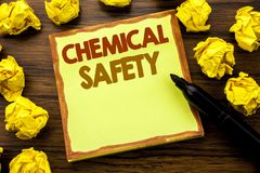 Hand writing text caption showing Chemical Safety. Business concept for Hazard Health At Work Written on sticky note paper, wooden. Background marker folded Stock Photography