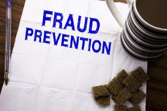 Hand writing text caption showing Fraud Prevention. Business concept for Crime Protection written on tissue paper on the wooden ba. Hand writing text caption Stock Photo