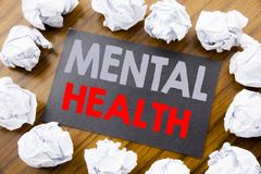 Hand writing text caption showing Mental Health. Business concept for Anxiety Illness Disorder written on sticky note paper on the. Hand writing text caption royalty free stock image
