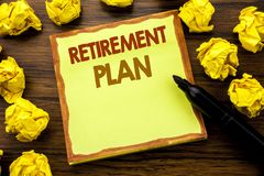 Hand writing text caption showing Retirement Plan. Business concept for Pension Finance Written on sticky note paper, wooden backg Royalty Free Stock Images