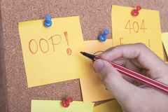 Hand writing text 404 error and oops on sticky note.  Stock Image