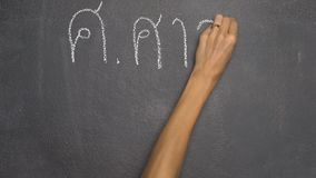Hand writing Thai letter on black chalkboard stock footage
