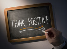 Hand writing Think positive on chalkboard Royalty Free Stock Photo