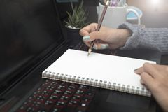 Hand writing to do list in blank notebook. Business hand writing to do list in blank notebook Stock Photo