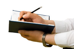 Hand writing to a notebook. Close up Royalty Free Stock Photos
