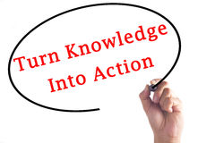 Hand writing Turn Knowledge Into Action on transparent board.  Royalty Free Stock Image