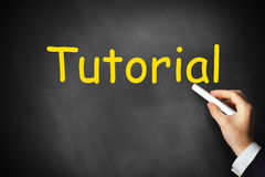 Hand writing tutorial on black chalkboard Stock Image