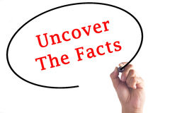 Hand writing Uncover The Facts on transparent board.  Stock Images