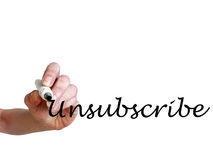 Hand writing Unsubscribe with black marker. On transparent whiteboard Stock Photos