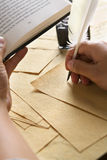 Hand writing using quill pen Royalty Free Stock Images