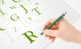 Hand writing various letters on white plain paper Stock Images