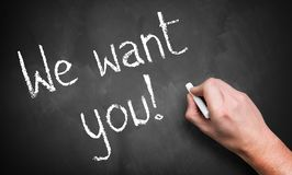 Hand writing `We want you!` on chalkboard royalty free stock photo