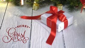 Hand Writing white Merry Christmas animation calligraphy lettering text on white wooden background with gifts and stock footage