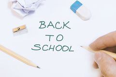 Hand is writing on whiteboard back to school idea concept royalty free stock photography