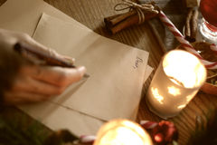 Hand writing wishes for Santa on Christmas Royalty Free Stock Photography