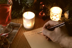 Hand writing wishes for Santa on Christmas Royalty Free Stock Photos