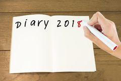 "Hand writing word ""diary 2018"" on notebook stock photography"