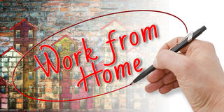 Hand writing `Work from home`. With new technology you can work at home - Concept image Stock Photography