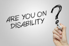Hand writing are you on disability Royalty Free Stock Images
