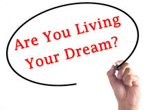 Hand writing Are You Living Your Dream? on transparent board.  royalty free stock image
