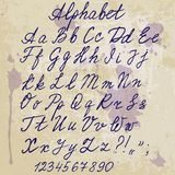 Hand-written alphabet on old paper with blots Stock Images