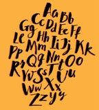 Hand written alphabet. On yellow background stock illustration