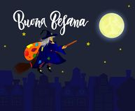 Hand written brush lettering phrase Buona Befana. Meaning Happy Epiphany with witch on broomstick against the background of night city. Template of greeting royalty free illustration