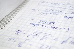 Hand written calculations. Hand written maths calculations on the exercise book Stock Image