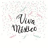 Viva Mexico lettering quote. Hand written calligraphic Spanish lettering quote Viva Mexico with falling confetti in flag colors. Isolated objects. Vector Stock Photos