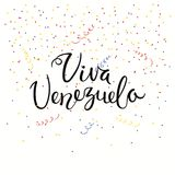 Viva Venezuela lettering quote. Hand written calligraphic Spanish lettering quote Viva Venezuela with falling confetti in flag colors. Isolated objects. Vector Royalty Free Stock Photo