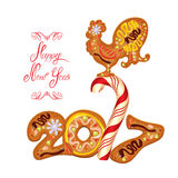 Hand written calligraphic text Happy New Year 2017,  on. White background. Year number as cookies. Winter holidays design. Stylized rooster from Chinese Stock Image