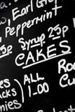 Hand written chalk menu board featured the word Cakes prominentl. Y in the centre Stock Photos