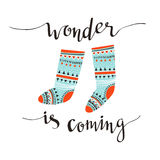 Hand-written Christmas holiday design with calligraphy - Wonder is coming. Isolated on white background. royalty free illustration
