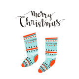 Hand-written Christmas lettering and christmas socks for gifts isolated on white background.  Season vector holiday  design. Hand-written Christmas lettering Royalty Free Stock Photo