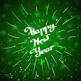 Hand-written Happy New Year with beam over green background Royalty Free Stock Photo