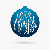 Hand written inscription Merry Christmas in ball. Hand written calligraphic inscription Merry Christmas in paper style on blue Christmas ball. Design element for royalty free illustration