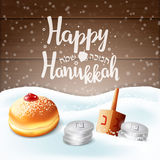Hand written lettering with text `Happy Hanukkah`on wooden background. Stock Photos