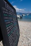 Hand Written Menu On Beach Outside Greek Taverna stock images