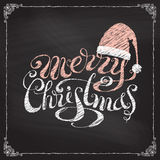 Hand-written Merry Christmas on blackboard background. Stock Photography