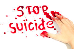 Hand-written message Stop Suicide with blood. Royalty Free Stock Photography